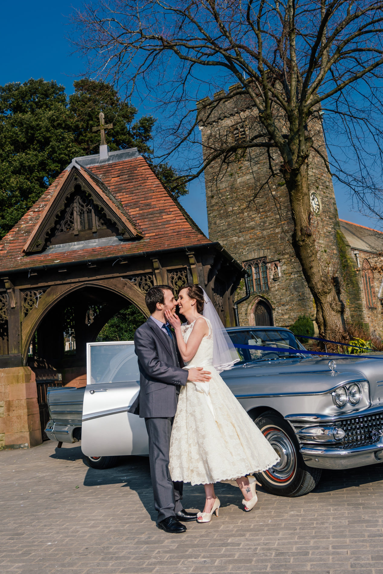 Wedding at Llanelli Parish Church with 1950s Buick wedding car